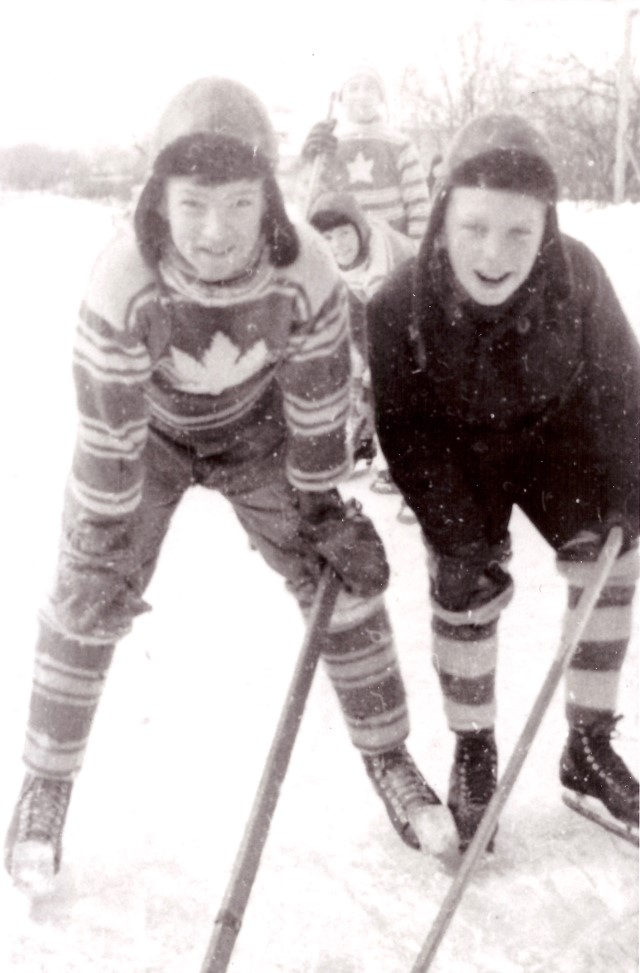 A young Bill Fitsell (left) on the ice in Lindsay